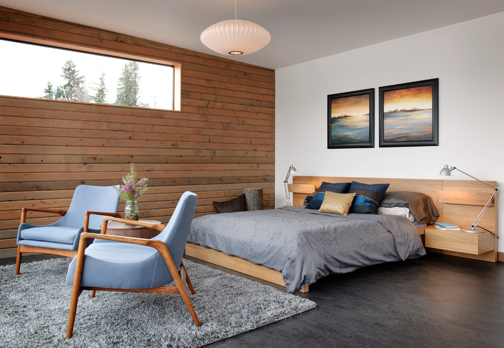 Inspiration for an industrial concrete floor and gray floor bedroom remodel in Seattle
