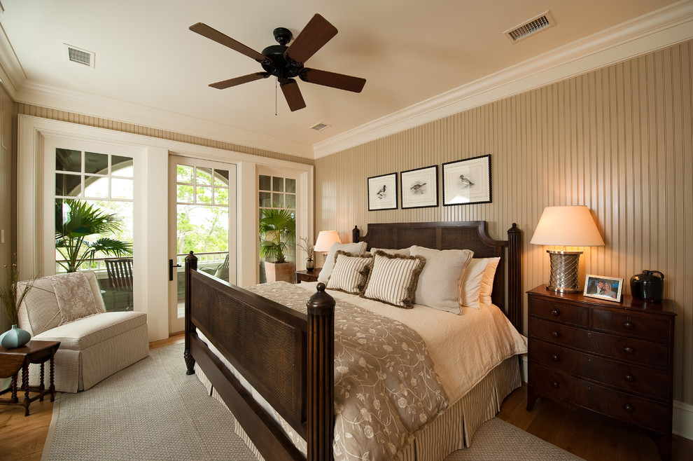 Inspiration for a timeless medium tone wood floor bedroom remodel in Charleston with beige walls