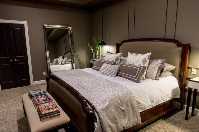 Bedroom - large contemporary master carpeted bedroom idea in New Orleans with gray walls, a standard fireplace and a stone fireplace