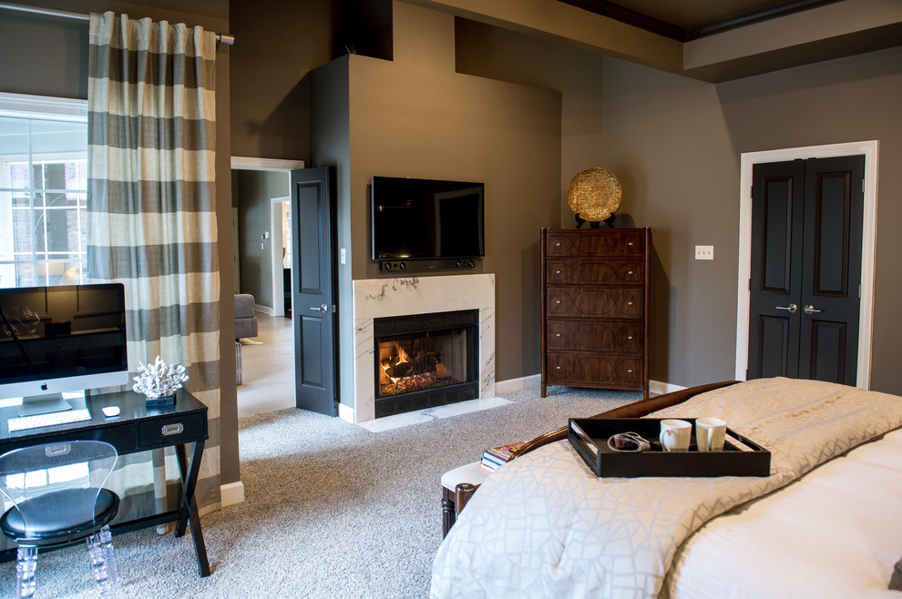 Inspiration for a large contemporary master carpeted bedroom remodel in New Orleans with gray walls, a standard fireplace and a stone fireplace
