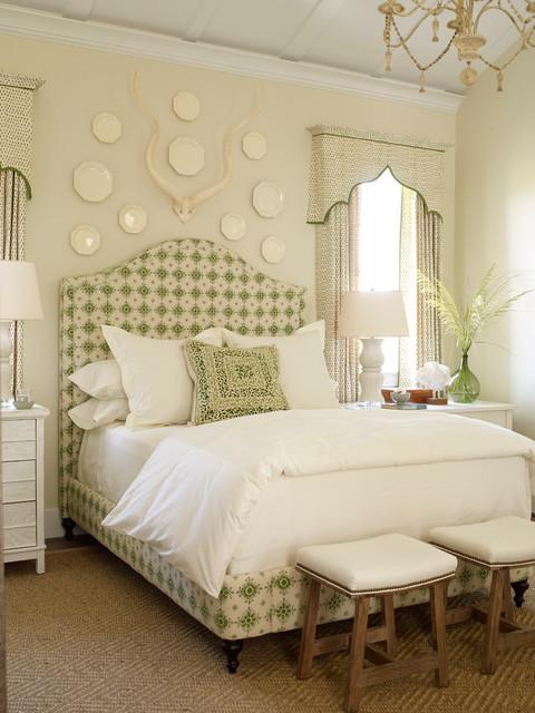 Elegant master bedroom photo in Jacksonville with beige walls