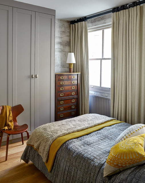 Inspiration for a transitional light wood floor bedroom remodel in London