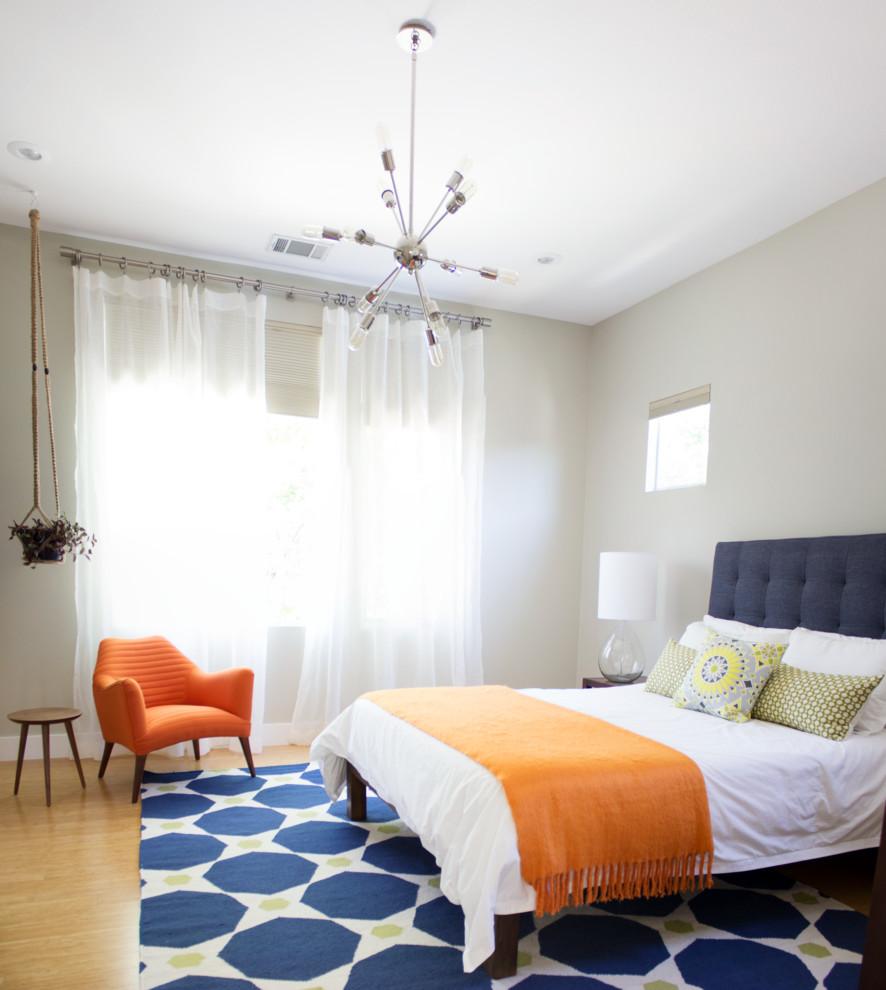 Example of a 1950s light wood floor bedroom design in Austin