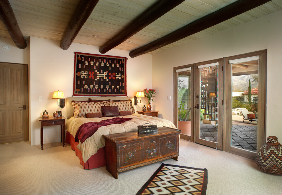 Southwest master carpeted bedroom photo in Phoenix with beige walls
