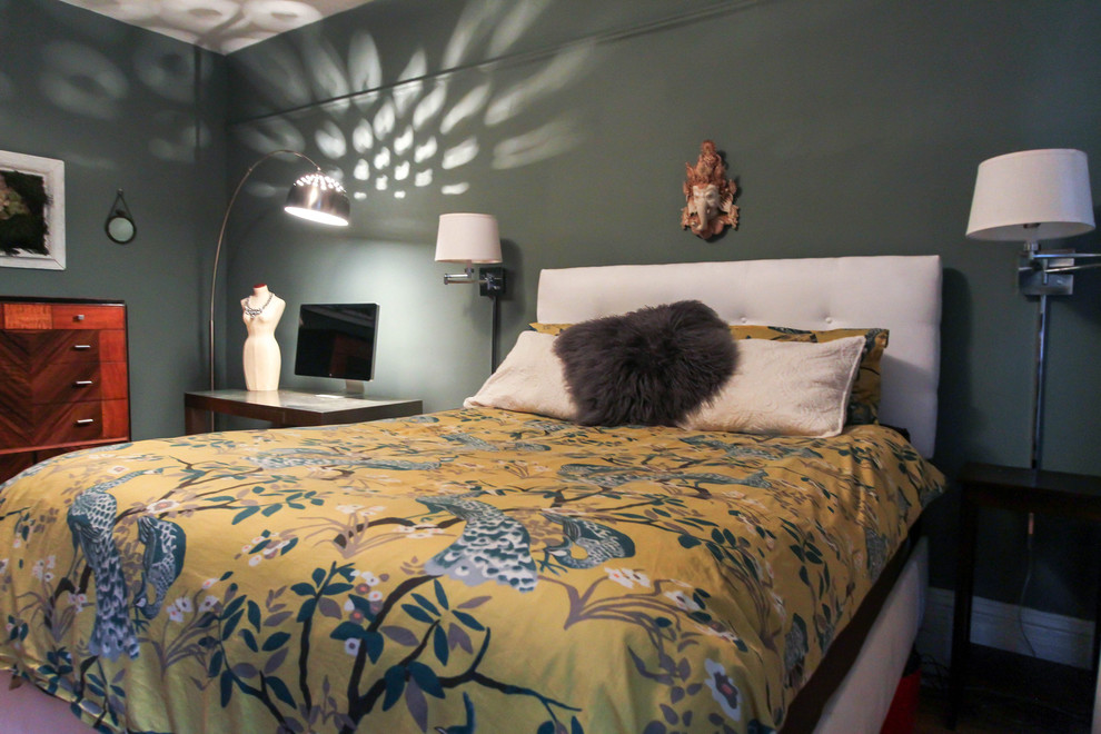 Example of a small trendy master medium tone wood floor bedroom design in New York with green walls and no fireplace