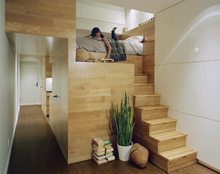 Bed with storage space below.
