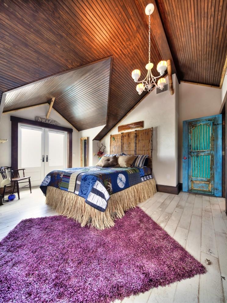 Bedroom - eclectic light wood floor bedroom idea in Tampa with beige walls
