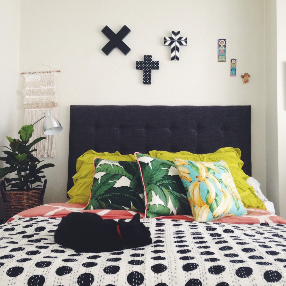 Mid-sized eclectic master bedroom photo in Melbourne with white walls