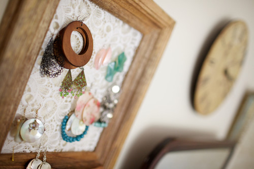 Picture frame and a scrap of lace as a jewelry holder