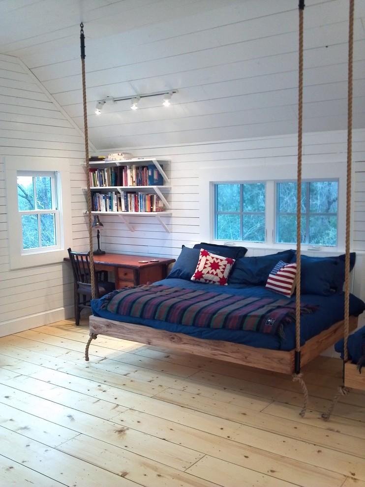 Bedroom - eclectic light wood floor bedroom idea in Nashville with white walls