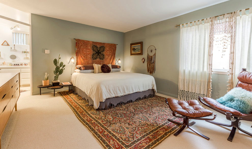 Inspiration for a large eclectic master carpeted and beige floor bedroom remodel in Los Angeles with green walls and no fireplace
