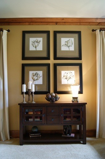 Example of a small transitional carpeted bedroom design in Atlanta with yellow walls