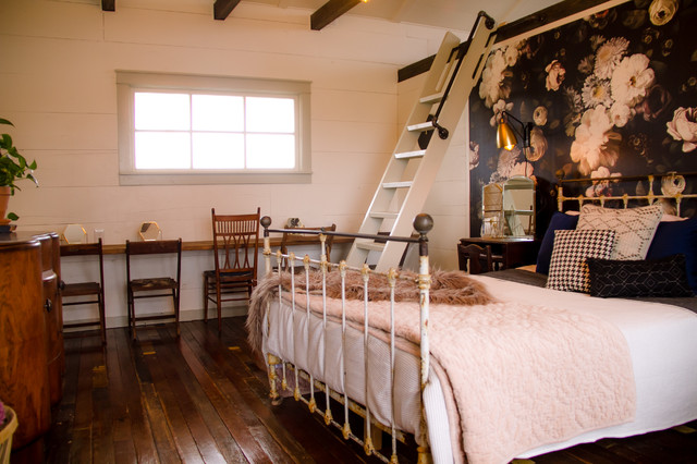 Large cottage master dark wood floor and brown floor bedroom photo in Austin with white walls