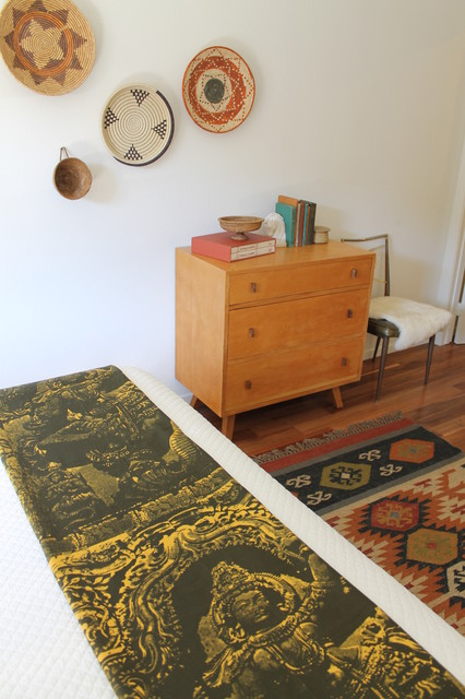 Eclectic Global Style With Kilim Rug And African Basket