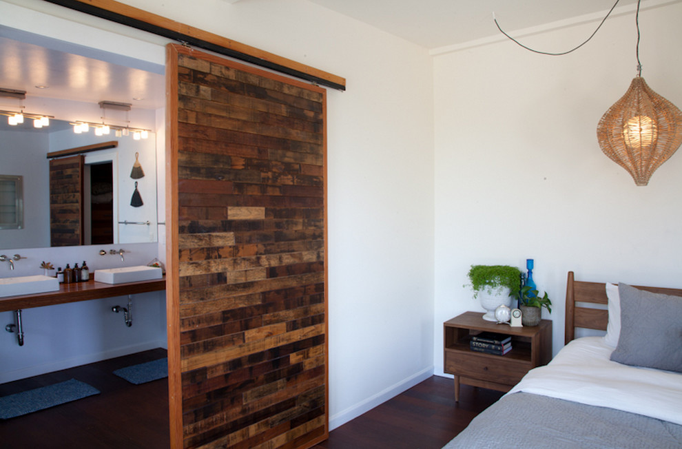 Inspiration for a 1950s master dark wood floor bedroom remodel in Los Angeles with white walls
