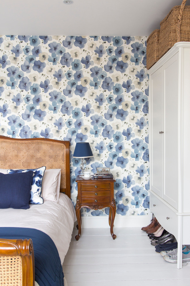 Bedroom - mid-sized victorian master painted wood floor and white floor bedroom idea in London with blue walls and no fireplace