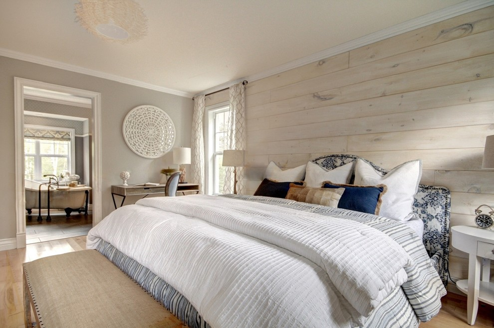 Inspiration for a mid-sized country master travertine floor and beige floor bedroom remodel in Other with gray walls and no fireplace