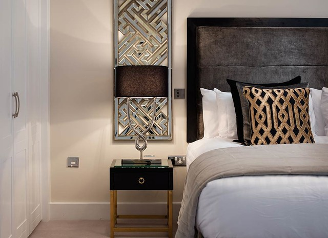 Example of a trendy master carpeted bedroom design in Dublin with beige walls