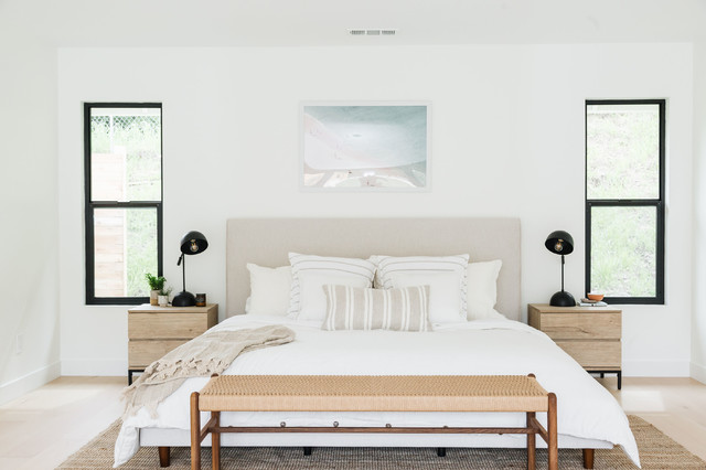 Inspiration for a beach style master light wood floor and beige floor bedroom remodel in San Diego with white walls and no fireplace