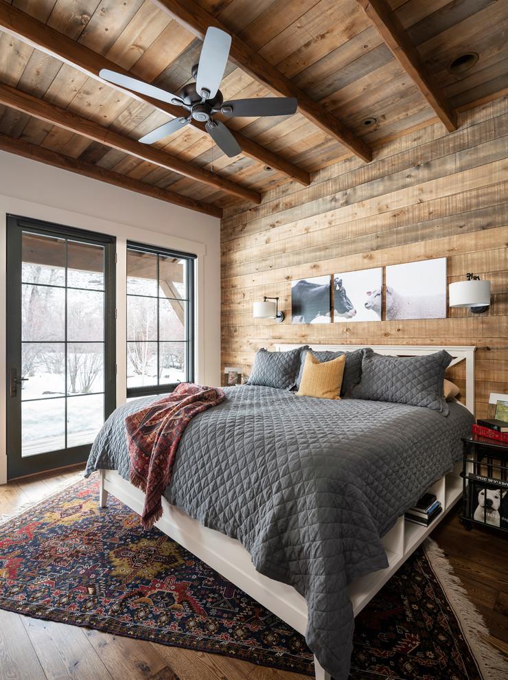 Bedroom - country dark wood floor and brown floor bedroom idea in Salt Lake City with white walls