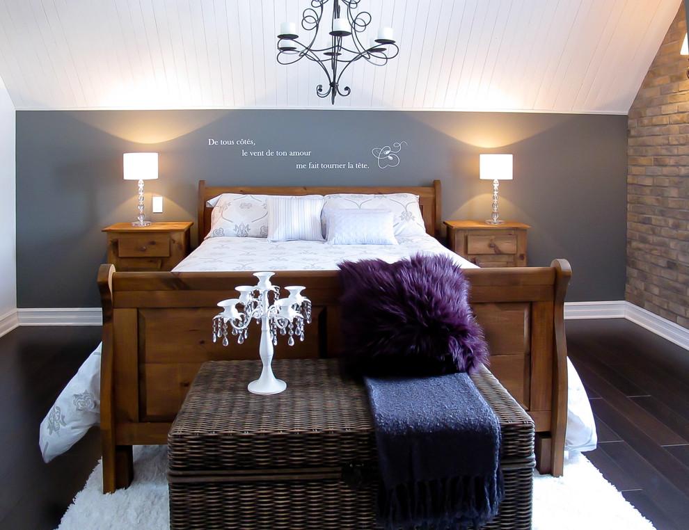 Example of a trendy dark wood floor bedroom design in Montreal with gray walls