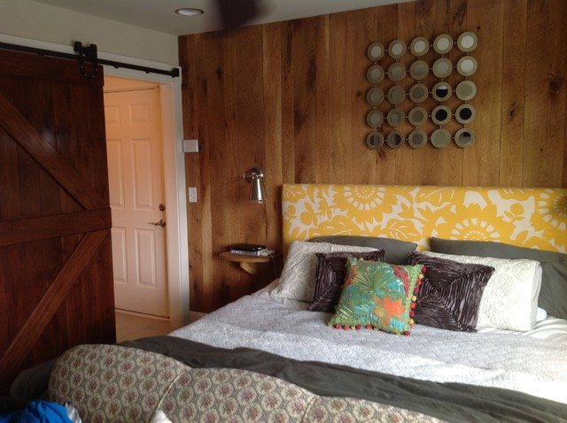 Every bedroom needs a barn door!  And a wall with barn siding to match! eclectic-bedroom