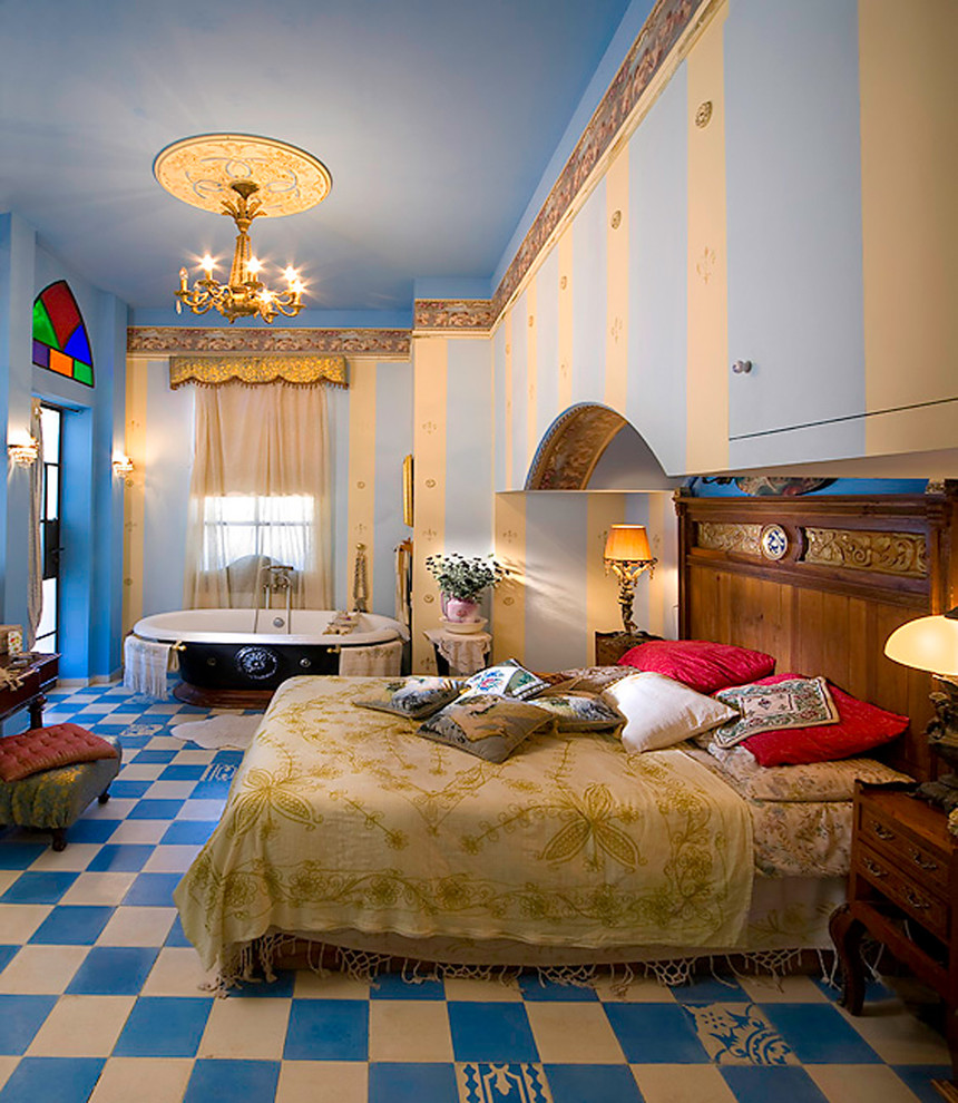 Inspiration for a mediterranean multicolored floor bedroom remodel in Other with blue walls