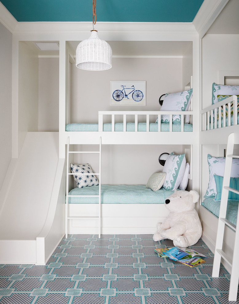 Example of a mid-sized beach style guest carpeted and multicolored floor bedroom design in Jacksonville with white walls