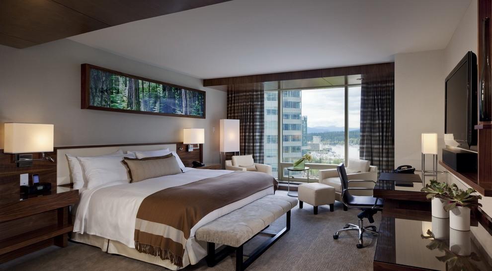 Example of a mid-sized trendy guest dark wood floor bedroom design in Vancouver with beige walls