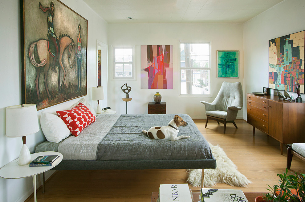 Inspiration for a mid-century modern light wood floor bedroom remodel in Houston with white walls and no fireplace