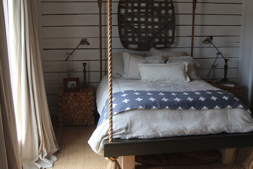 Inspiration for a small farmhouse guest light wood floor bedroom remodel in Nashville with white walls