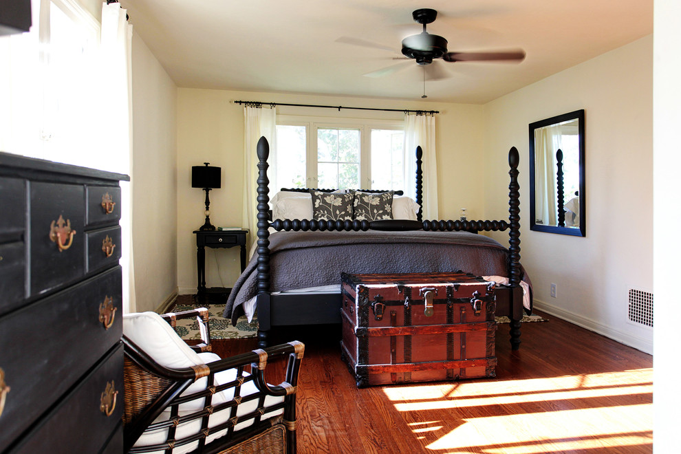 Example of a cottage medium tone wood floor bedroom design in Los Angeles with white walls and no fireplace