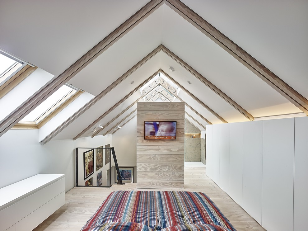 Example of a country light wood floor bedroom design in Other with white walls