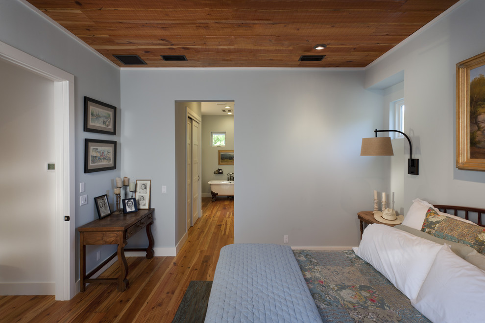 Inspiration for a cottage bedroom remodel in Austin with blue walls