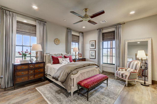 Inspiration for a country medium tone wood floor bedroom remodel in Oklahoma City with gray walls