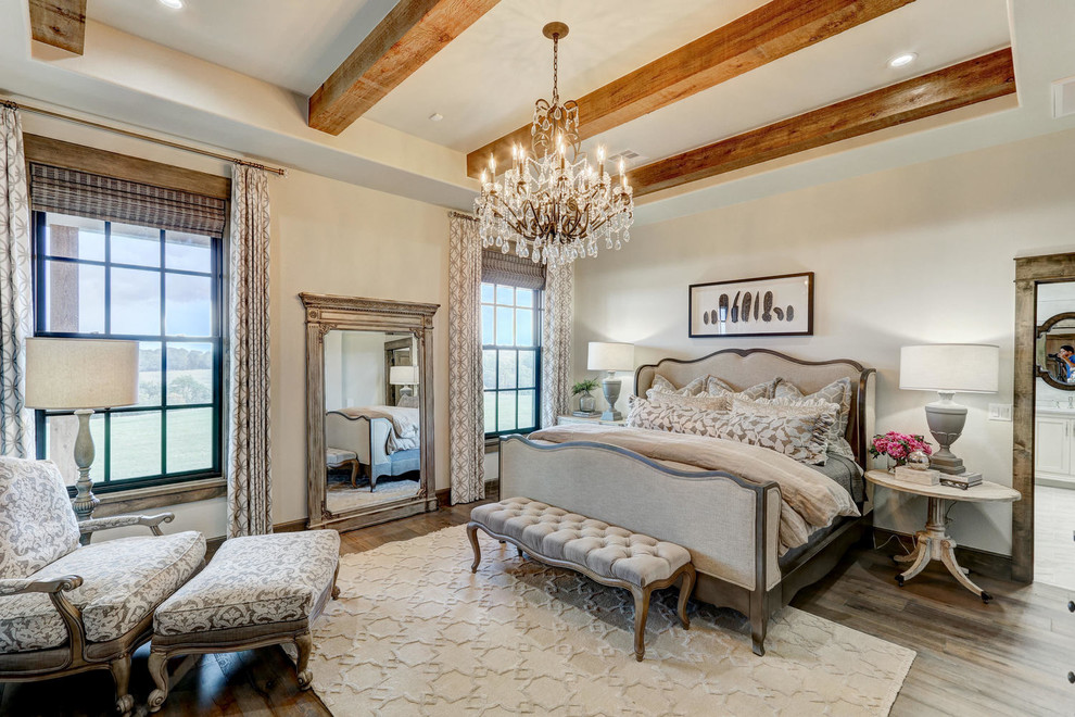 Inspiration for a farmhouse master medium tone wood floor bedroom remodel in Oklahoma City with beige walls