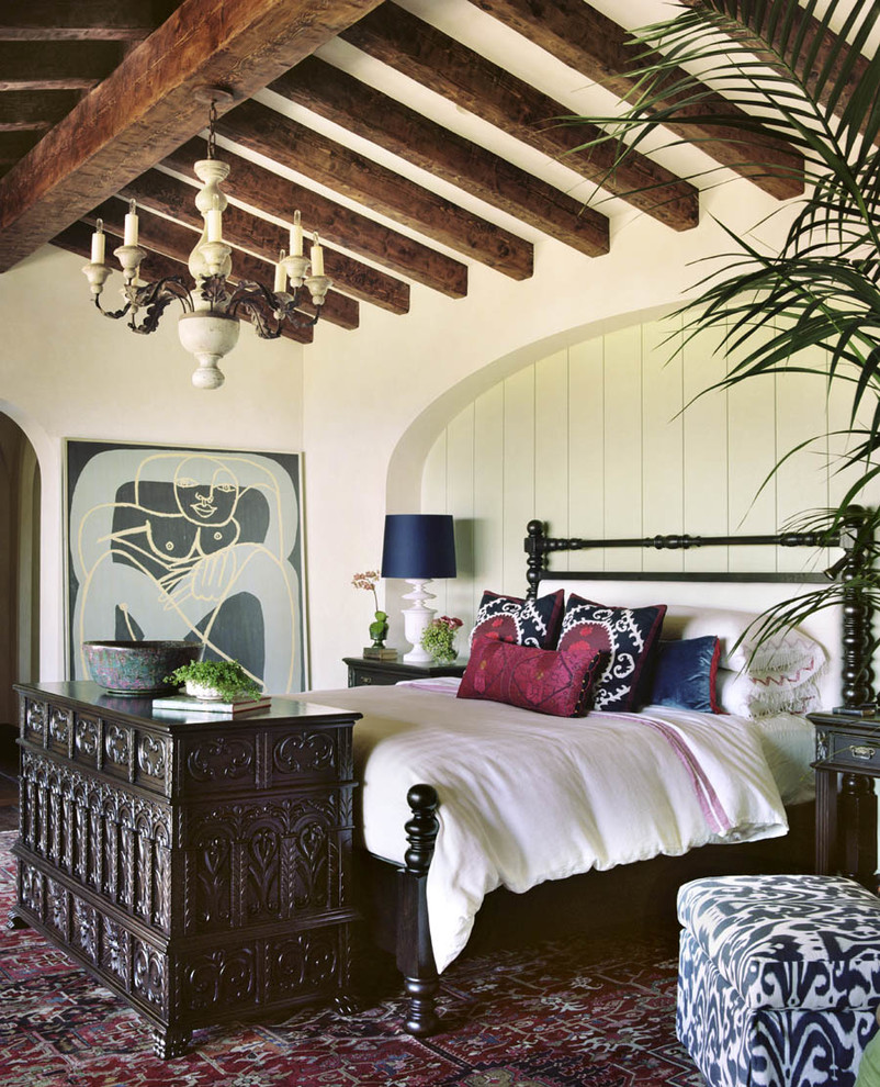 Large tuscan master carpeted and multicolored floor bedroom photo in Orange County with white walls