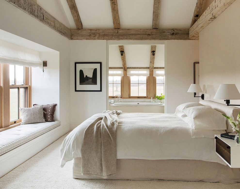 Inspiration for a mid-sized country master carpeted bedroom remodel in Other with white walls and no fireplace