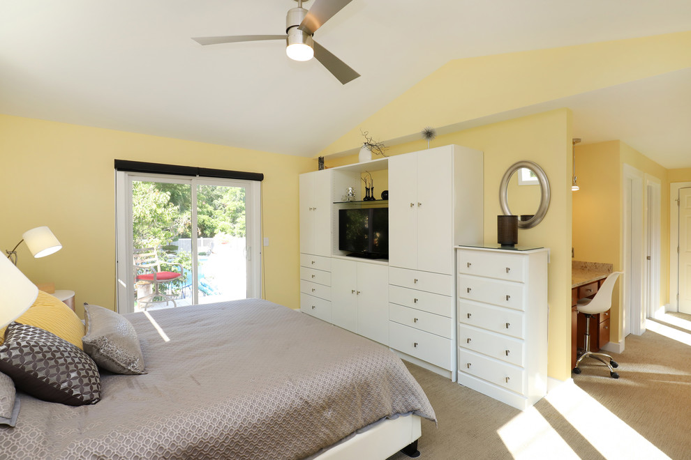Inspiration for a mid-sized transitional master carpeted and beige floor bedroom remodel in Grand Rapids with yellow walls and no fireplace