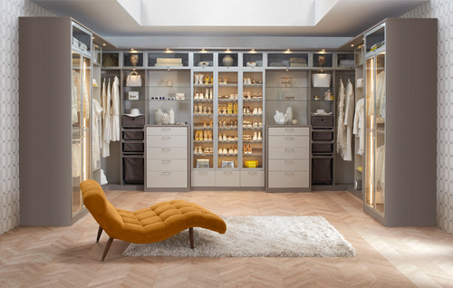 Modern style walk-in closet with lighted shoe storage.