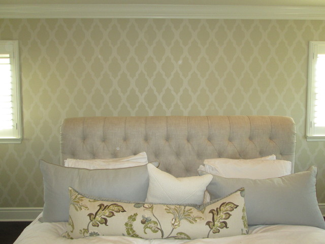 Example of a mid-sized trendy master bedroom design in Orange County with beige walls