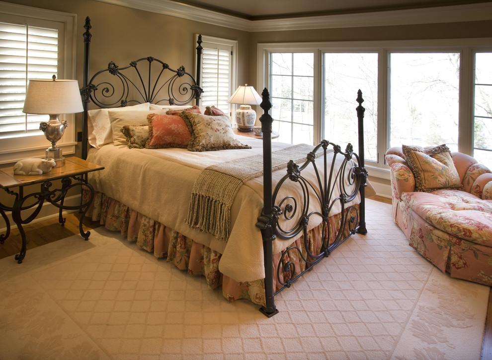 Elegant bedroom photo in Minneapolis with brown walls
