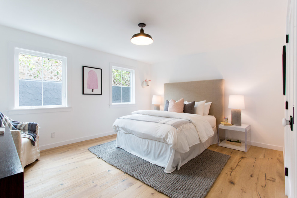 Inspiration for a country guest bedroom remodel in Los Angeles with white walls