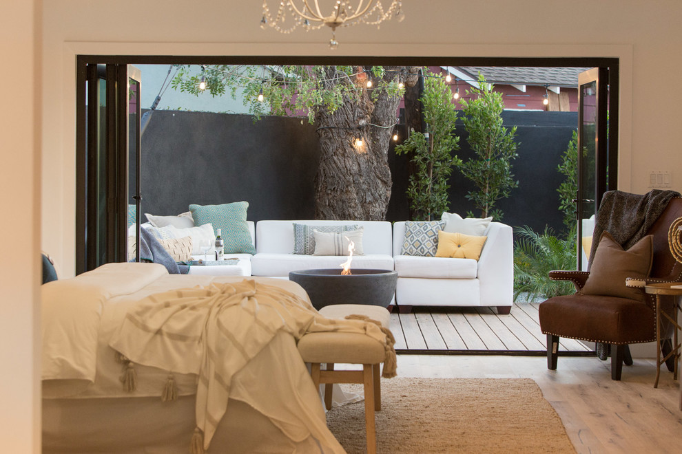 Bedroom - cottage master bedroom idea in Los Angeles with white walls