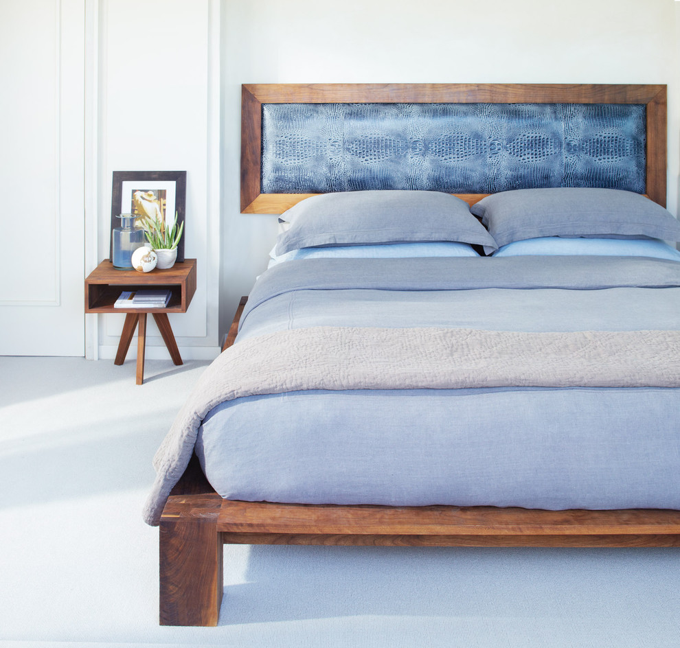 Example of a minimalist carpeted and blue floor bedroom design in San Francisco with gray walls