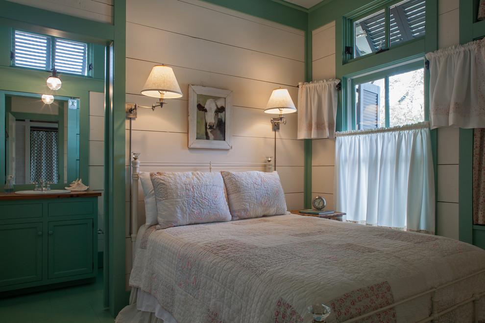 Example of a coastal bedroom design in Miami with multicolored walls