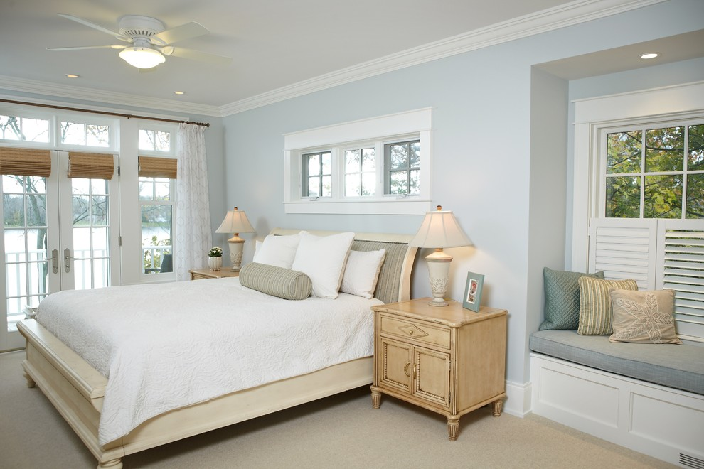 Inspiration for a large timeless master carpeted and beige floor bedroom remodel in Grand Rapids with blue walls