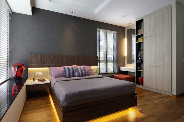 Trendy dark wood floor and brown floor bedroom photo in Singapore with gray walls