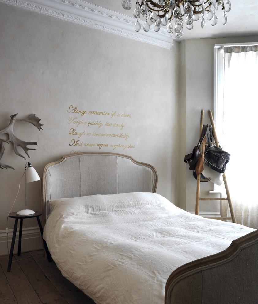 Cottage dark wood floor bedroom photo in London with gray walls
