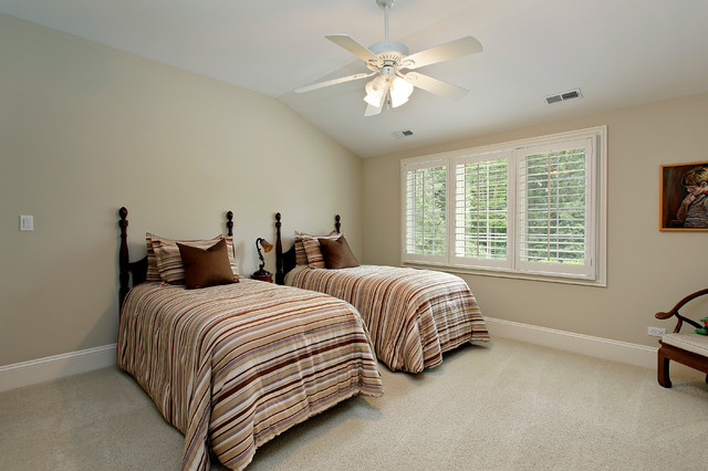 Example of a classic carpeted bedroom design in Denver